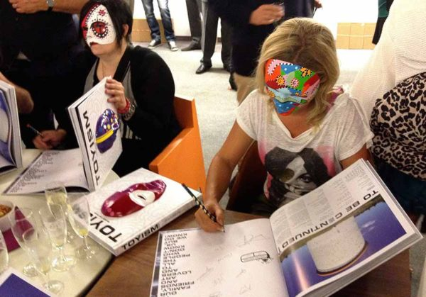 Toyists Signing Toyism Behind the Mask - Toyism Art Movement